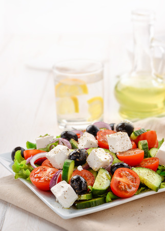 drink food: Fresh vegetable greek salad isolated on white Stock Photo