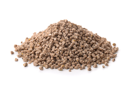 Pile of compound feed pellets isolated on white