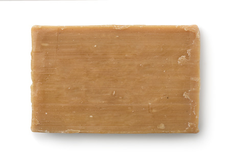 soap sud: Top view of old soap bar isolated on white