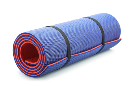 mat: Rolled blue foam yoga mat isolated on white Stock Photo