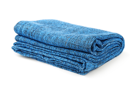 Folded blue warm blanket isolated on white Imagens