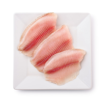 Top view of  plate with raw fish fillet isolated on white