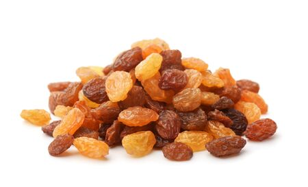 Pile of mixed raisins isolated on white