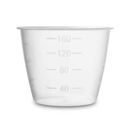 measuring: Plastic measuring cup isolated on white Stock Photo