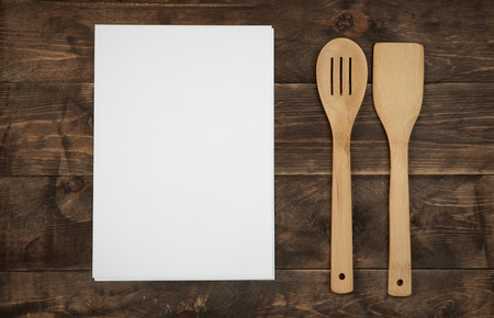 paper board: Wooden kitchenware and blank paper sheets for recipes on wood  board Stock Photo