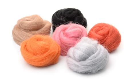 Group of color needle felting wool isolated on white Stock Photo