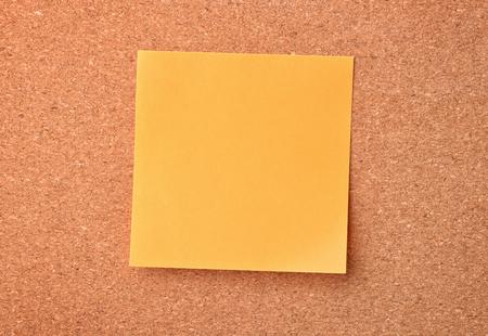 note board: Orange sticky note on cork board