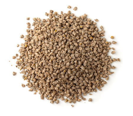 Top view of compound feed pellets isolated on white