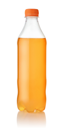 Small plastic bottle of orange soda isolated on white Banco de Imagens