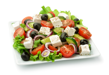 isolated on white: Square plate of greek salad isolated on white Stock Photo