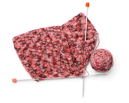 Top view of knitting with needles and yarn ball isolated on white Stock Photo
