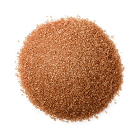 Top view of brown cane sugar heap isolated on white