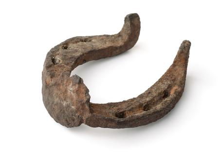 Antique rusty horseshoe isolated on white