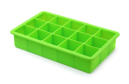 Green silicone ice cube tray isolated on white 스톡 콘텐츠