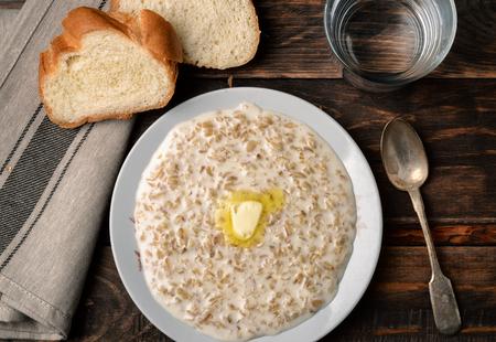wholegrain: Top view of atmeal porridge in bowl on dark wood background
