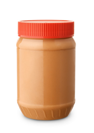 Jar of peanut butter isolated on white