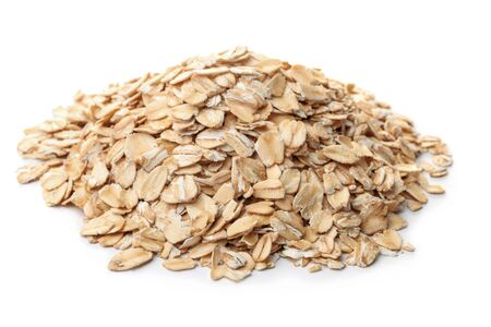 Pile of dry rolled oatmeal isolated on white
