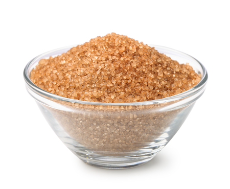 grained: Bowl of brown cane sugar isolated on white Stock Photo