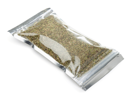 Plastic bag of  herb and spice mix isolated on white