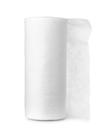 Rolled disposable nonwoven fabric towels isolated on white
