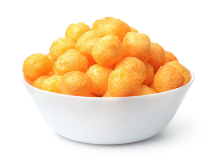 Bowl full of cheese puff balls isolated on white 免版税图像