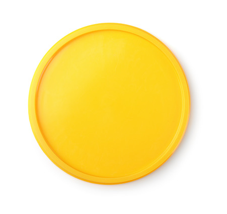 Top view of yellow plastic lid isolated on white