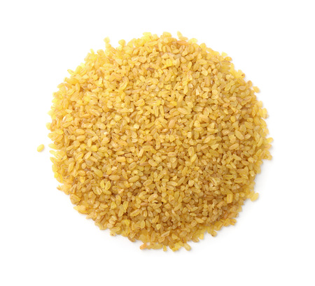 Top view of dry bulgur heap isolated on white