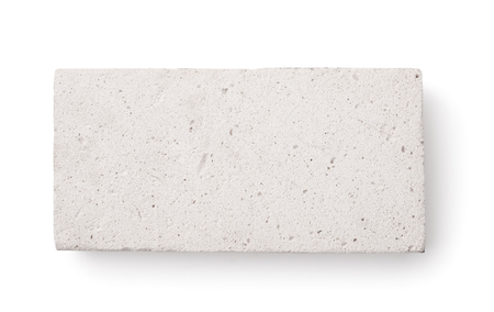 Top view of lightweight foamed gypsum brick isolated on white Stock Photo