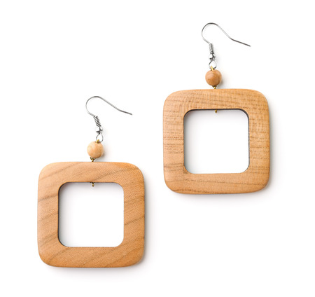 Pair of wooden earrings isolated on white 스톡 콘텐츠