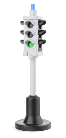 Toy plastic traffic light isolated on white