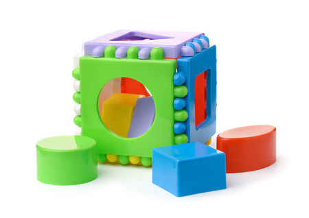 Plastic shape sorter cube and blocks isolated on white