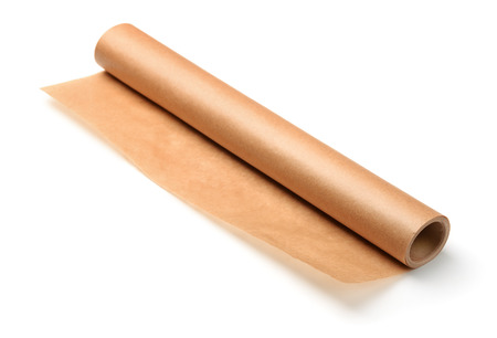 Roll of brown baking parchment paper isolated on white Imagens