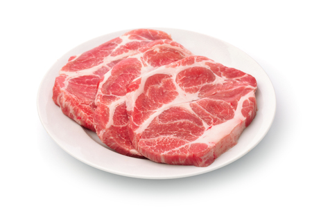 Raw fresh pork neck meat steaks isolated on white