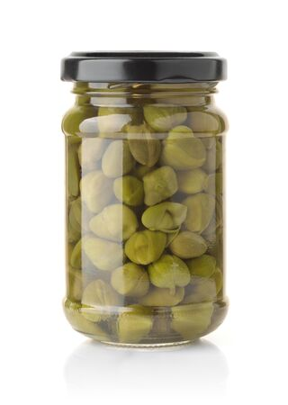 Glass jar of pickled capers isolated on white