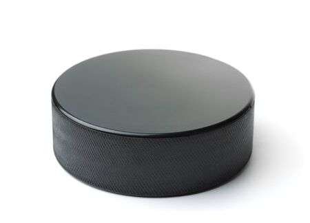 Black ice hockey puck isolated on white