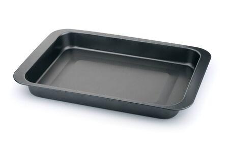 New empty black non-stick baking tray isolated on white