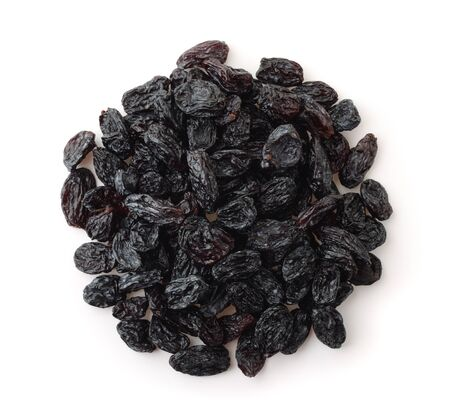 Top view of black raisins isolated on white Imagens