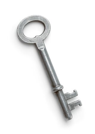 Top view of old metal key isolated on white Banco de Imagens