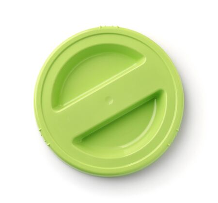 Top view of green round plastic lid isolated on white
