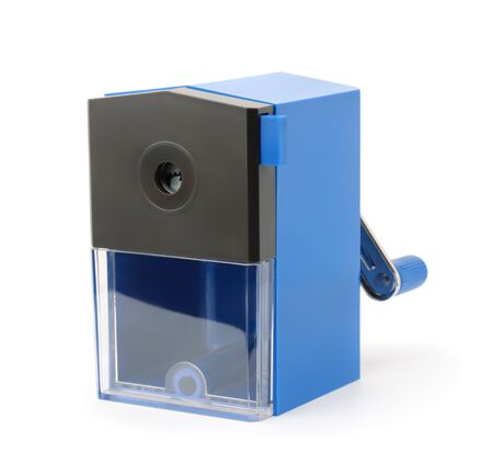 Blue plastic pencil sharpener isolated on white