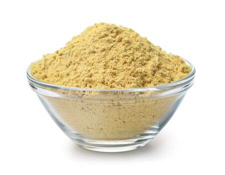 Glass bowl of mustard powder isolated on white