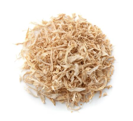 Top view of shredded dried ginger isolated on white