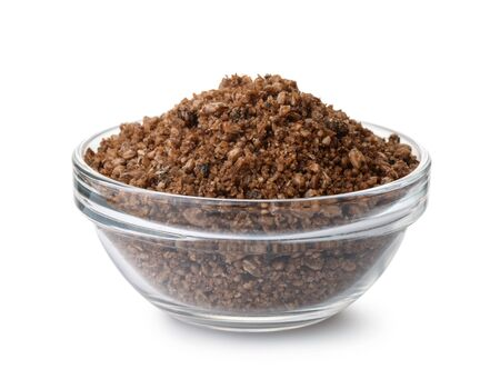 Glass bowl of fish feeding mix isolated on white
