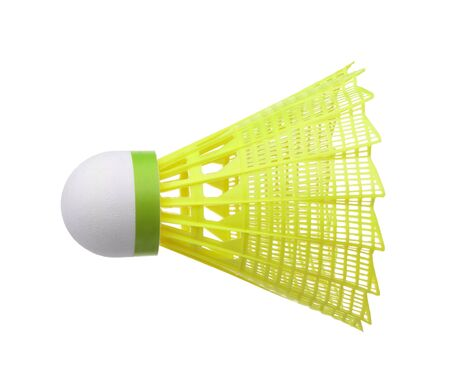 Side view of yellow plastic shuttlecock isolated on white