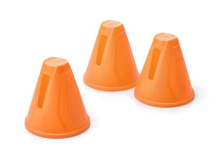 Plastic orange slalom skating cones isolated on white