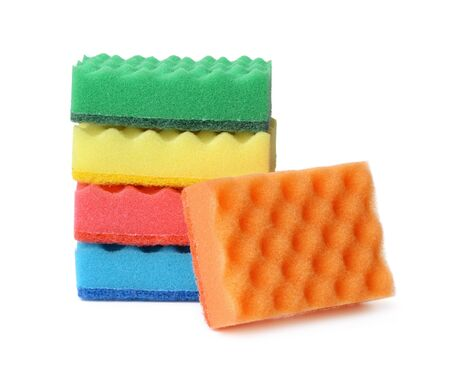 Stack of colorful plasdtic dishwashing sponges isolated on white