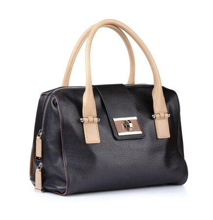 Black female leather handbag isolated on white