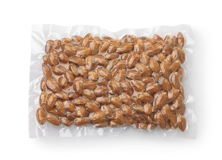Vacuum plastic bag of almond nuts isolated on white