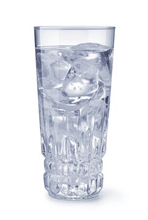 Crystal glass of water with ice isolated on a white