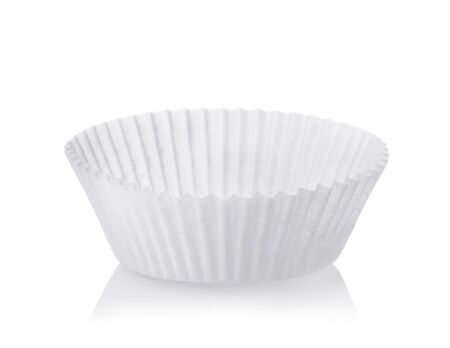 White cupcake baking paper cups isolated on white
